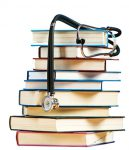 Photo of a pile of books and stethoscope